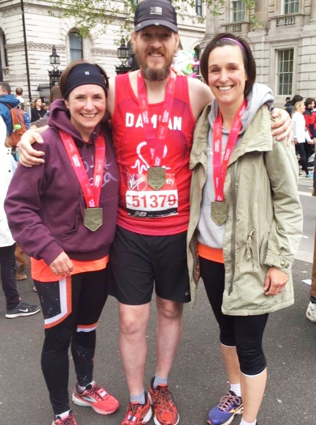 Damian Ashton, with his medal (and two 'marathon cousins') after completing the 2019 London Marathon